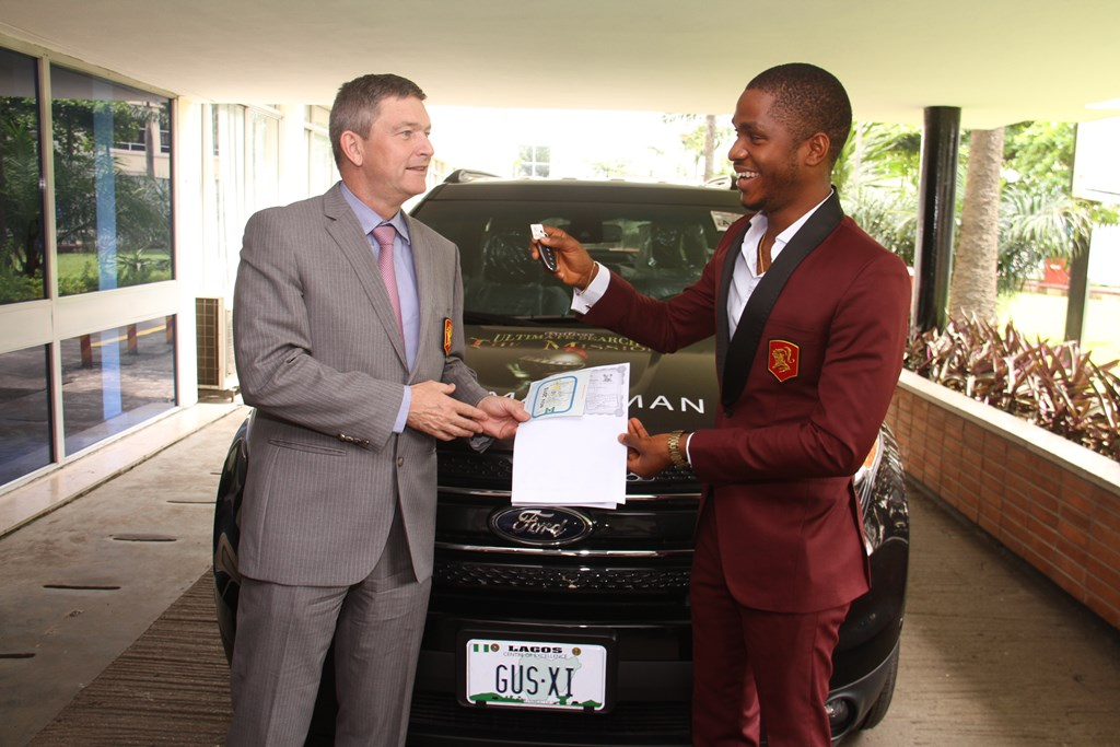 Nicolaas Vervelde (left), Managing Director and CEO, Nigerian   Breweries Plc., presenting the keys to a brand new SUV to Chinedu   Ubachukwu (right), winner, Gulder Ultimate Search 11, for emerging the   Ultimate Champion, at the official prize presentation ceremony held at   the Nigerian Breweries Plc. headquarters, Iganmu, Lagos on Wednesday,   November 12.