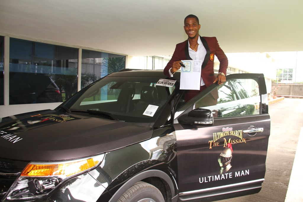 Chinedu Ubachukwu, winner, Gulder Ultimate Search 11, standing near   his brand new SUV, after the car was officially presented to him, at   the Nigerian Breweries Plc. headquarters, Iganmu, Lagos on Wednesday,   November 12.