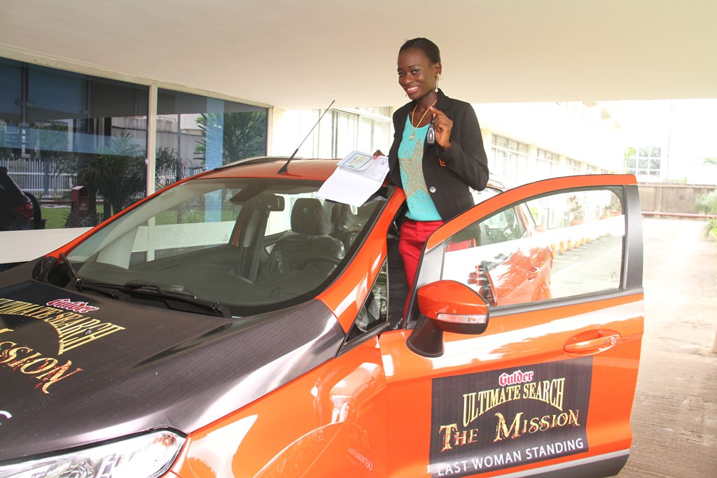 Samantha Appi, Last Woman Standing, Gulder Ultimate Search 11,   standing near her brand new Ford Focus, after the car was officially   presented to her, at the Nigerian Breweries Plc. headquarters, Iganmu,   Lagos on Wednesday, November 12.