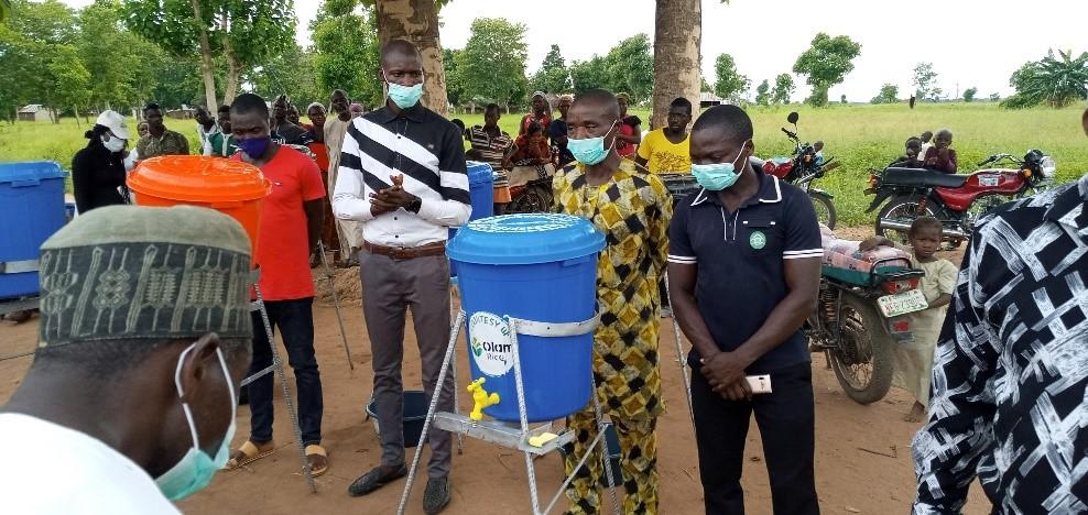 Handing over of hand washing equipment to head teachers